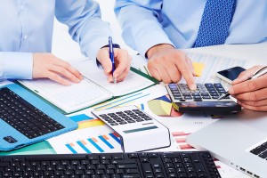 Accountants maintaining cost accounting system in a Sydney business